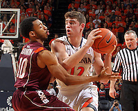 Virginia guard Joe Harris (12) is defended by Virginia Tech guard Marquis Rankin (10) during the game Tuesday in Charlottesville, VA. Virginia defeated Virginia Tech73-55.