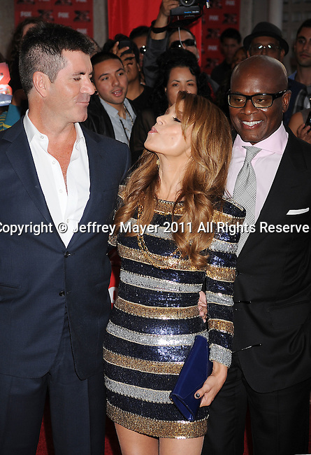 "HOLLYWOOD CA - SEPTEMBER 14: Simon Cowell, Paula Abdul, Antonio ""L.A."" Reid attend the ""The X Factor"" World Premiere Screening at ArcLight Cinemas on September 14, 2011 in Hollywood, California."