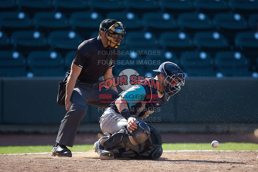 Lynchburg Hillcats catcher Gavin Collins (9) blocks a pitch in the dirt as home plate umpire Steven Hodgins looks on during the game against the Winston-Salem Rayados at BB&T Ballpark on June 23, 2019 in Winston-Salem, North Carolina. The Hillcats defeated the Rayados 12-9 in 11 innings. (Brian Westerholt/Four Seam Images)