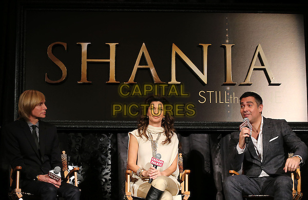 """Marc Bouwer, Shania Twain, Raj Kapoor.At a press conference for """"Shania: Still The One"""" at The Colosseum at Caesars Palace Hotel and Casino, Las Vegas, Nevada, USA, .30th November 2012..half length cream white top gold necklace slit sleeves boots black cream trousers beige sitting .CAP/ADM/MJT.© MJT/AdMedia/Capital Pictures."""