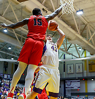 Stony Brook defeats UAlbany  69-60 in the America East Conference tournament quaterfinals at the  SEFCU Arena, Mar. 3, 2018.  Akwasi Yeboah (#15) defends a Greg Stire (#43) shot.