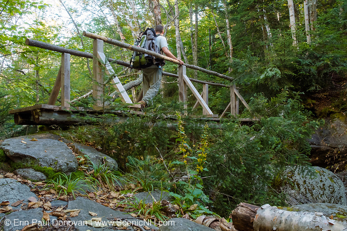 A hiker on the Randolph Path at Sanders Bridge in the White Mountain National Forest of New Hampshire USA.