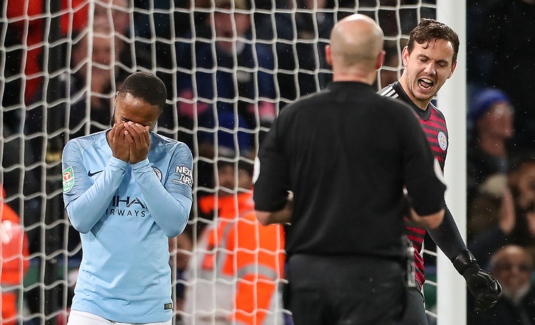 Manchester City 's Raheem Sterling despairs after missing a penalty as Leicester City 's goalkeeper  Danny Ward looks on<br /> <br /> Photographer Andrew Kearns/CameraSport<br /> <br /> English League Cup - Carabao Cup Quarter Final - Leicester City v Manchester City - Tuesday 18th December 2018 - King Power Stadium - Leicester<br />  <br /> World Copyright © 2018 CameraSport. All rights reserved. 43 Linden Ave. Countesthorpe. Leicester. England. LE8 5PG - Tel: +44 (0) 116 277 4147 - admin@camerasport.com - www.camerasport.com