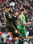 30.11.2019,  GER; 2. FBL, FC St. Pauli vs Hannover 96 ,DFL REGULATIONS PROHIBIT ANY USE OF PHOTOGRAPHS AS IMAGE SEQUENCES AND/OR QUASI-VIDEO, im Bild Hendrik Weydandt (Hannover #26) versucht sich gegen James Lawerence (Pauli #21) und Philipp Ziereis (Pauli #04) durchzusetzen Foto © nordphoto / Witke *** Local Caption ***