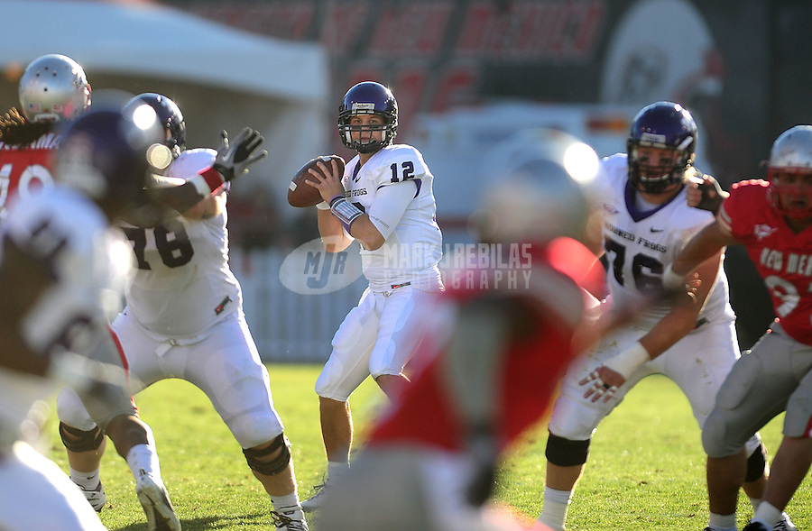 Nov. 27, 2010; Albuquerque, NM, USA; TCU Horned Frogs quarterback (12) Yogi Gallegos drops back to pass in the second quarter against the New Mexico Lobos at University Stadium. TCU defeated New Mexico 66-17 to finish the season undefeated. Mandatory Credit: Mark J. Rebilas-