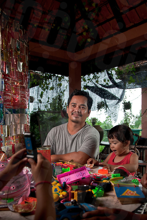 July 15, 2010 - Battambang, Cambodia. Artist Sre Bandol in his home and studio. © Nicolas Axelrod / Ruom