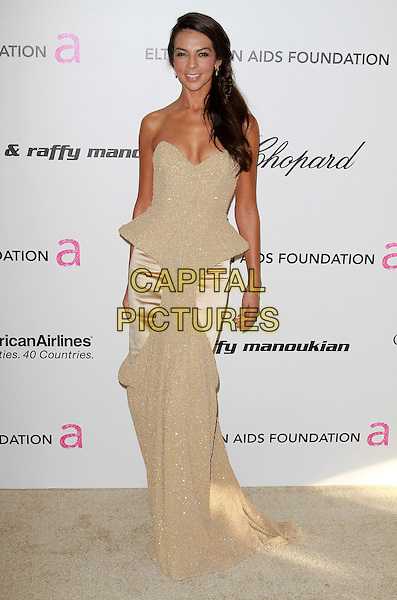 TERRI SEYMOUR .19th Annual Elton John AIDS Foundation Academy Awards Viewing Party held at The Pacific Design Center, West Hollywood, California, USA..February 27th, 2011.full length gold beige cream strapless peplum silk satin dress sparkly .CAP/ADM/FS.©Faye Sadou/AdMedia/Capital Pictures.