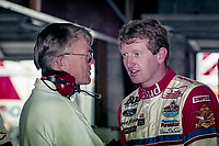 DAYTONA BEACH, FL - JUL 2, 1994:  Bill Elliott, R, talks with Joe Gibbs in the garage before the Pepsi 400 NASCAR Winston Cup race at Daytona International Speedway, Daytona Beach, FL. ((Photo by Brian Cleary/www.bcpix.com)
