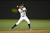 Shortstop Hansel Moreno (12) of the Columbia Fireflies throws out a runner during a game against the Charleston RiverDogs on Wednesday, August 29, 2018, at Spirit Communications Park in Columbia, South Carolina. Charleston won, 6-1. (Tom Priddy/Four Seam Images)