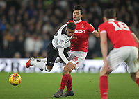 Derby County's Jayden Bogle battles with  Nottingham Forest's Claudio Yacob<br /> <br /> Photographer Mick Walker/CameraSport<br /> <br /> The EFL Sky Bet Championship - Derby County v Nottingham Forest - Monday 17th December 2018 - Pride Park - Derby<br /> <br /> World Copyright © 2018 CameraSport. All rights reserved. 43 Linden Ave. Countesthorpe. Leicester. England. LE8 5PG - Tel: +44 (0) 116 277 4147 - admin@camerasport.com - www.camerasport.com
