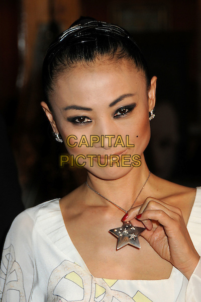 "BAI LING.""Fast & Furious"" Los Angeles Premiere at the Universal City Walk Gibson Amphitheatre, Universal City, California, USA..March 12th, 2009.headshot portrait white silver star necklace hand.CAP/ADM/BP.©Byron Purvis/AdMedia/Capital Pictures."