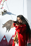 A young Native American Indian boy holding a gun