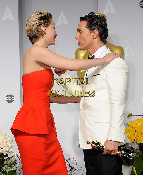 HOLLYWOOD, CA - MARCH 2: Jennifer Lawrence, Matthew McConaughey in the press room at the 2014 Oscars at the Hollywood and Highland Center in Hollywood, California. March 2, 2014. <br /> CAP/MPI/COR99<br /> &copy;COR99/MediaPunch/Capital Pictures