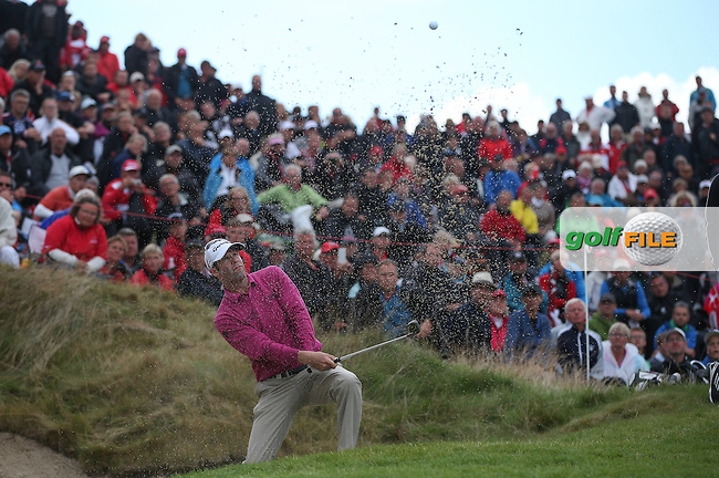 Bradley Dredge (WAL) climbs out of the bunker of the dramatic 16th hole watched by over a crowd of 21k during the Final Round of Made in Denmark 2014, from the Himmerland Golf & Spa Resort, Aalborg, Denmark. Picture:  David Lloyd / www.golffile.ie
