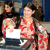 "New Carrollton, MD - January 29, 2005 -- Nagim Mohammed Renahy, formerly of the Kurdish Zarko City, votes in the Iraqi election in New Carrollton, Maryland on January 29, 2005.  Ms. Renahy was very excited about voting because she is Kurdish and this is her first free election.  She said ""it is a Kurd's dream to vote for another Kurd in the Iraqi election"".  Ms. Renahy currently resides in Springfield, Virginia..Credit: Ron Sachs / CNP..(RESTRICTION: NO New York or New Jersey Newspapers or newspapers within a 75 mile radius of New York City)"