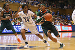 24 February 2012: Miami's Suriya McGuire (33) drives against Duke's Ka'lia Johnson (14). The Duke University Blue Devils defeated the University of Miami Hurricanes 74-64 at Cameron Indoor Stadium in Durham, North Carolina in an NCAA Division I Women's basketball game.