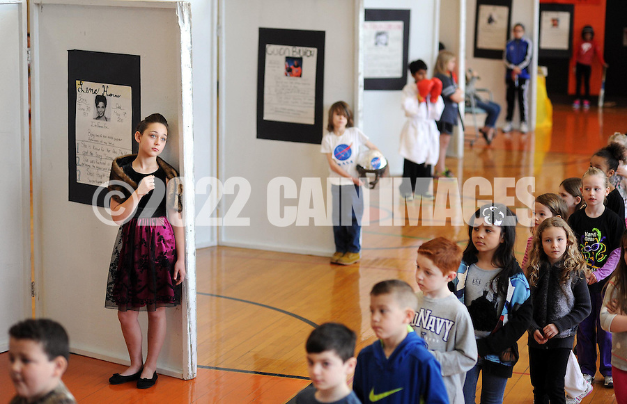 "A group of first graders walks through as the 5th grade creates a ""wax museum"" of historic black figures to celebrate Black History Month at Fallsington Elementary School Monday February 23, 2015 in Fallsington, Pennsylvania. (Photo by William Thomas Cain/Cain Images)"