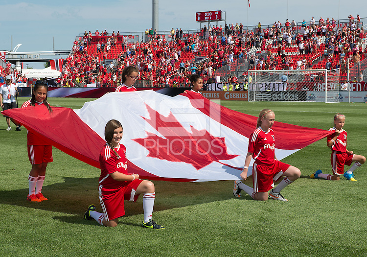 July 20, 2013: The flag kids hold the Canadian flag during the opening ceremonies in a game between Toronto FC and the New York Red Bulls at BMO Field in Toronto, Ontario Canada.<br /> The game ended in a 0-0 draw.