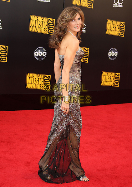 JULIE MORAN.2009 American Music Awards - Arrivals held at the Nokia Theatre L.A. Live, Los Angeles, California, USA..November 22nd, 2009.AMA AMA's AMAS full length brown strapless silk satin dress beads beaded looking over shoulder .CAP/ADM/MJ.©Michael Jade/AdMedia/Capital Pictures.