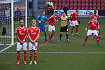 Home players Moses Odubajo (left) and David Mooney line up in a defensive wall during the second half of Crewe Alexandra's home game against Leyton Orient in the SkyBet League One at the Alexandra Stadium, Gresty Road, Crewe. The match was won by the visitors from London by 2-1 with two goals on debut by Chris Dagnall, sending Orient to the top of the league. The match was watched by 4830 spectators.