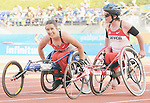 November 17 2011 - Guadalajara, Mexico:  Christy Campbell and Rachael Burrows after the 100m - T34 final in the Telmex Athletic's Stadium at the 2011 Parapan American Games in Guadalajara, Mexico.  Photos: Matthew Murnaghan/Canadian Paralympic Committee