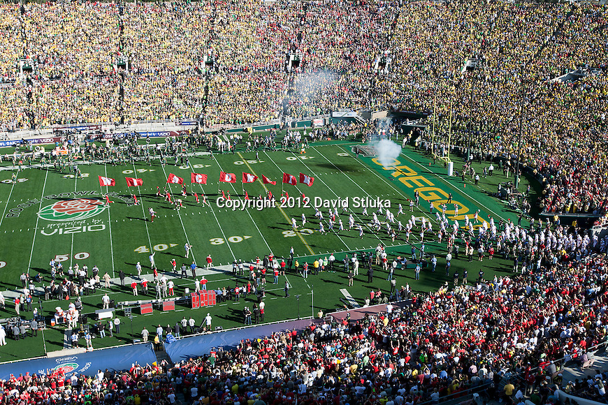 Wisconsin Badgers football team takes the field prior to the 2012 Rose Bowl NCAA football game against the Oregon Ducks in Pasadena, California on January 2, 2012. The Ducks won 45-38. (Photo by David Stluka)