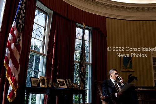 United States President Barack Obama talks on the phone with President Mahmoud Abbas of the Palestinian Authority in the Oval Office, March 19, 2012. .Mandatory Credit: Pete Souza - White House via CNP