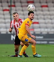 Lincoln City's Harry Anderson vies for possession with Northampton Town's David Buchanan<br /> <br /> Photographer Chris Vaughan/CameraSport<br /> <br /> Emirates FA Cup First Round - Lincoln City v Northampton Town - Saturday 10th November 2018 - Sincil Bank - Lincoln<br />  <br /> World Copyright © 2018 CameraSport. All rights reserved. 43 Linden Ave. Countesthorpe. Leicester. England. LE8 5PG - Tel: +44 (0) 116 277 4147 - admin@camerasport.com - www.camerasport.com