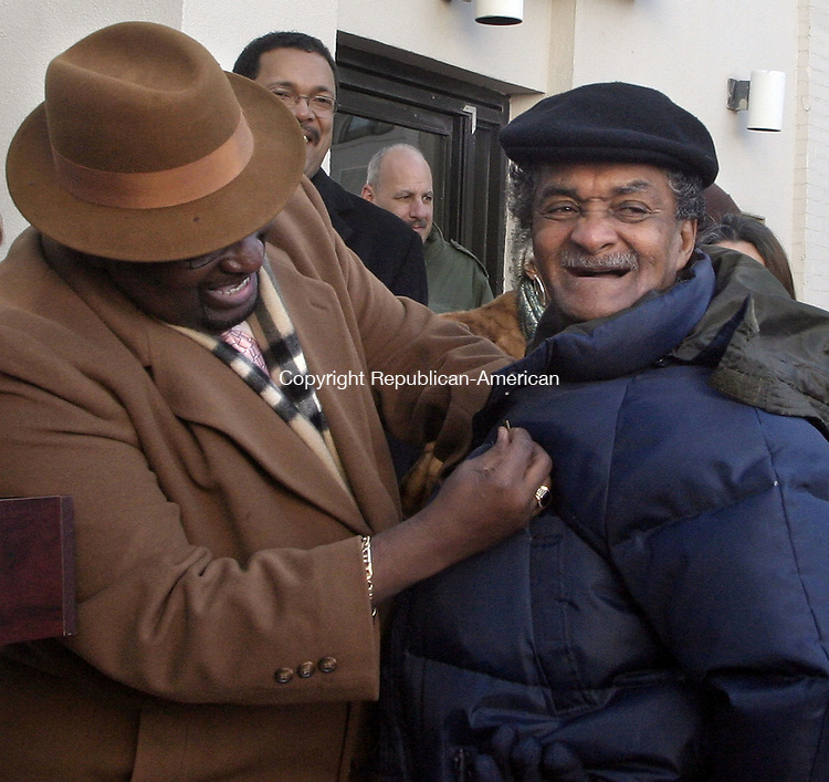 WATERBURY, CT -31 JANUARY 2007 -013108DA03- Mack G. Daniels receives a pin from Dennis King, MLK Holiday Commission, during a dedication ceremony to honor Daniels at New Opportunities in Waterbury Wednesday. The courtyard there was renamed Mackie G. Daniels Place and the day was named after him in his honor.<br /> Darlene Douty/Republican-American