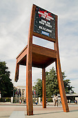 "In September 1997 Handicap International unveiled the ""Broken Chair"" outside the United Nations in Geneva, Switzerland.  The 12 metre high wooden sculpture was made by Swiss artist Daniel Berset in support of the global movement to eradicate landmines."