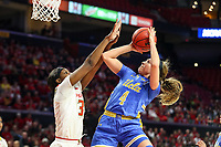College Park, MD - March 25, 2019: UCLA Bruins guard Lindsey Corsaro (4) is fouled by Maryland Terrapins forward Brianna Fraser (34) during game between UCLA and Maryland at  Xfinity Center in College Park, MD.  (Photo by Elliott Brown/Media Images International)