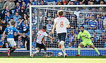Tom Taiwo scores the second goal for Falkirk past Rangers keeper Cammy Bell