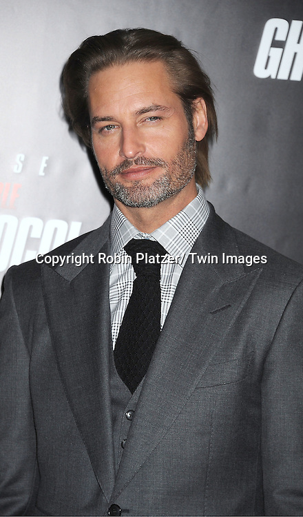 "Josh Holloway attends The US Premiere of "" Mission:Impossible - Ghost Protocol "" on December 19, 2011 at the Ziegfeld Theatre. ..the movie stars Tom Cruise, Paula Patton, Jeremy Renner, Simon Pegg, Josh Holloway, Michael Nyqvist and Anil Kapoor."