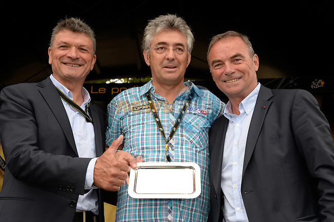 Marc Madiot director sportive FDJ.FR receives recognition from Bernard Hinault and Bernard Thevenet ASO for the number of Tours he has participated in before the start of Stage 8 of the 2014 Tour de France running 161km from Tomblaine to Gerardmer La Mauselaine. 12th July 2014.<br /> Photo ASO/B.Bade/www.newsfile.ie