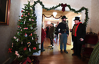 NWA Democrat-Gazette/J.T.WAMPLER Bob Underdown of Elm Springs (right) visits with Robert Kroening Sunday Dec. 1, 2019 during the Holiday Open House at Washington County Historical Society at Headquarters House in Fayetteville. Underdown is dressed in clothes typical in the 1860s and Kroening is dressed as a trooper in the First Arkansas Calvary, a Union regiment that was stationed in Fayetteville during the Civil War.