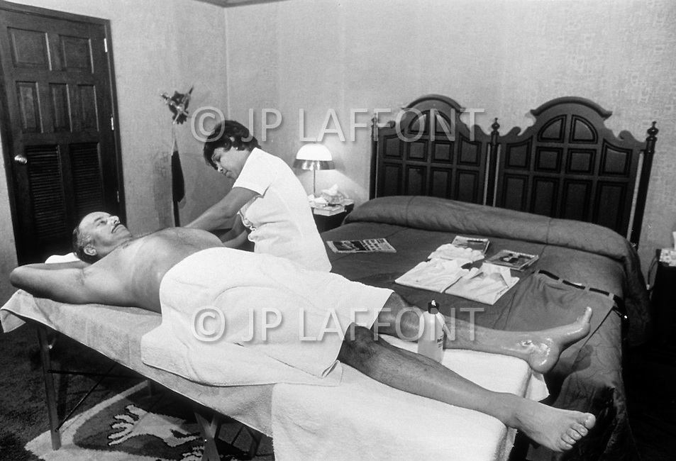 Managua, Nicaragua. March 1, 1978. President Anastasio Somoza having a massage in his office. Nicaraguan dictator Anastasio Somoza, who took over from his father Anastasio Somoza Garcia, then his eldest brother Luis, after the latter assassinated their father, ruled as President of Nicaragua between 1967-1972 and again in 1974, until the Sandinista revolution in 1979, which finally put an end to the dictatorial regime of the Somoza family.