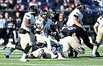 SIOUX FALLS, SD, NOVEMBER 26:  Park Parish #15 from Harding University pitches the ball to Zach Shelley #28 in the second quarter against the University of Sioux Falls Saturday afternoon at Bob Young Field in Sioux Falls. (Photo by Dave Eggen/Inertia)