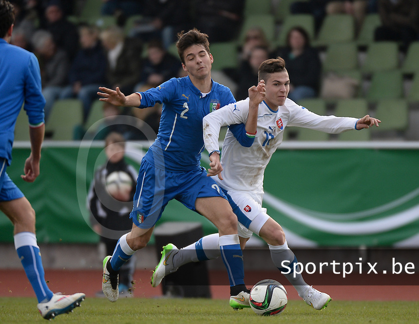 20150323 - MARBURG , GERMANY  : duel pictured between Slovakian Lubomir Tupta (right) and Italian Giuseppe Scalera (left)  during the soccer match between Under 17 teams of Slovakia and Italy , on the second matchday in group 8 of the UEFA Elite Round Under 17 at Georg-Gassmann , Marburg Germany . Monday 23 rd  March 2015 . PHOTO DAVID CATRY