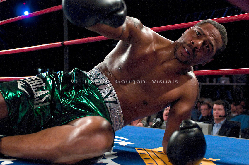 Madison Square Garden, New York, Oct. 10th,2009: Monte Barrett dazed on the canvas after being knocked down by Odlanier Solis during their 10 rounds Heavyweight fight. Solis won by TKO in round two. Photo by Thierry Gourjon.