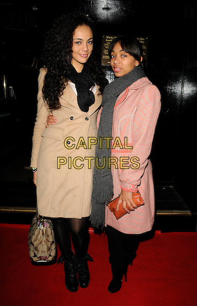 GUEST & ZARAAH ABRAHAMS .Attending the Michael Jackson Experience game launch at Whisky Mist, London, England, UK, .November 18th 2010..full length red orange beige coat  scarf grey gray brown clutch bag tights black .CAP/CAN.©Can Nguyen/Capital Pictures.