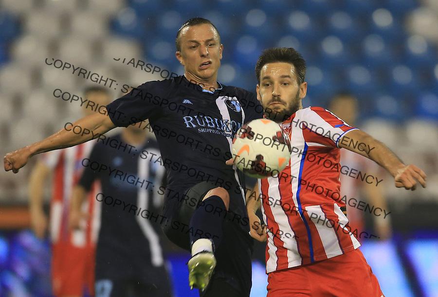Fudbal Jelen super league season 2013-2014<br /> Crvena Zvezda v Rad <br /> Srdja Knezevic (L) and Milos Ninkovic<br /> Beograd, 05.03.2014.<br /> foto: Srdjan Stevanovic/Starsportphoto&copy;