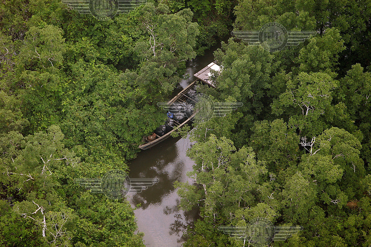 Boat used for theft of oil, socalled bunkering, moored in a river of the Niger Delta near a Shell facility. Bunkering causes much pollution as well as loss of revenues for the oil companies. © Fredrik Naumann