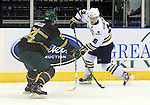 SIOUX FALLS, SD - DECEMBER 7:  Dennis Kravchenko #18 from the Sioux Falls Stampede controls the puck as Tyler Mueller #24 from the Sioux City Musketeers defends in the first period of their game Saturday night at the Sioux Falls Arena. (Photo by Dave Eggen/Inertia)
