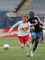 New York Red Bulls' Chris Leitch (33) and San Jose Earthquakes' Kei Kamara (16) chase down the ball in the first half of an MLS soccer match at Giants Stadium in East Rutherford, N.J. on Sunday, April 27, 2008. The Red Bulls defeated the Earthquakes 2-0.