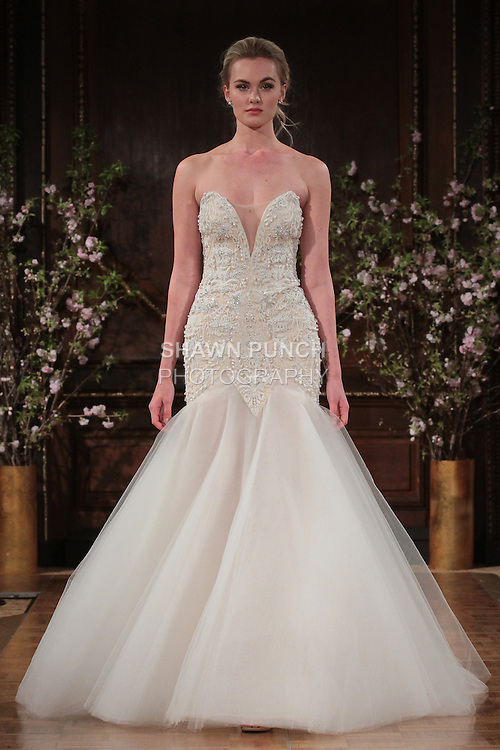 "Model walks runway in a ""Shane"" bridal gown from the Isabelle Armstrong Spring Collection 2017, at Lotte New York Palace Hotel, during New York Bridal Fashion Week Spring Summer 2017 on April 16, 2017."