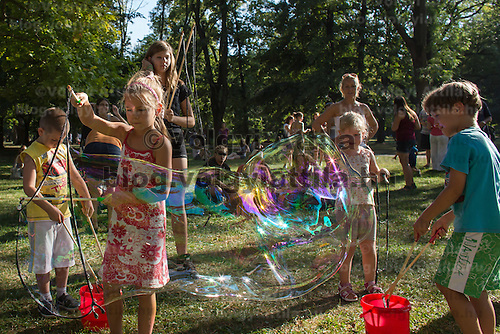 Girl blows soap bubbles during a soap bubble day in a public park in Budapest, Hungary on August 19, 2012. ATTILA VOLGYI