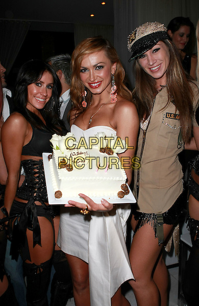 KARINA SMIRNOFF.celebrates her birthday at Pure Nightclub inside Caesar's Palace Resort Hotel and Casino, Las Vegas, Nevada, USA, 2nd January 2010..half length strapless white dress cake necklace dangly earrings flowers peach cake .CAP/ADM/MJT.©MJT/Admedia/Capital Pictures