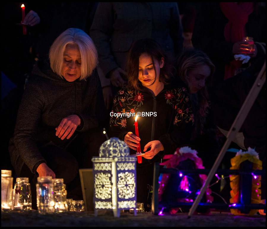 BNPS.co.uk (01202 558833)<br /> Pic: PhilYeomans/BNPS<br /> <br /> The seaside town of Swanage paid its respects to tragic teenager Gaia Pope(19) at a vigil held last night.<br /> <br /> Gaia's body was found on a remote clifftop 12 days after going missing.<br /> <br /> Her family paid tribute to her and lit candles in her memory.