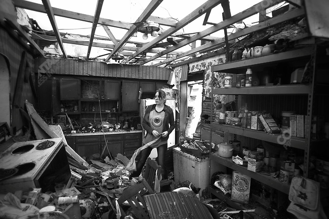 A resident sorts through what's left of a kitchen in Joplin, Mo. May 26, 2011...