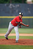 Birmingham Barons pitcher Raul Fernandez (31) delivers a pitch during a game against the Biloxi Shuckers on May 24, 2015 at Joe Davis Stadium in Huntsville, Alabama.  Birmingham defeated Biloxi 6-4 as the Shuckers are playing all games on the road, or neutral sites like their former home in Huntsville, until the teams new stadium is completed.  (Mike Janes/Four Seam Images)